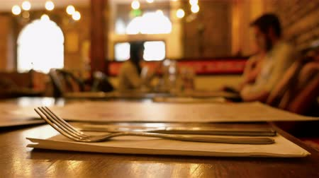 gourmet : Dinner in a restaurant. Group of people eating and talking. Gourmet food. Knife and fork in the front Stock Footage