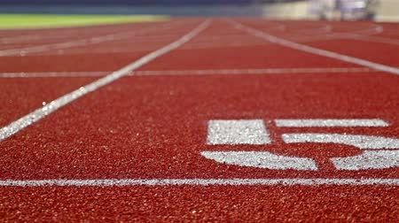 five striped : Running track with lane five on a stadium, dolly Stock Footage