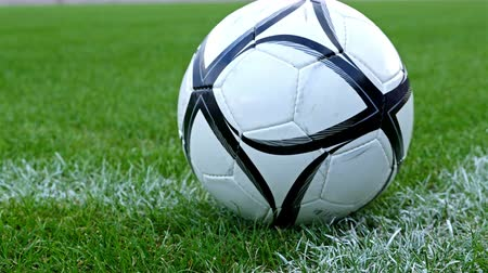 estádio : Footballsoccer concept. Dolly of a soccer ball put on the corner point of the football field Stock Footage