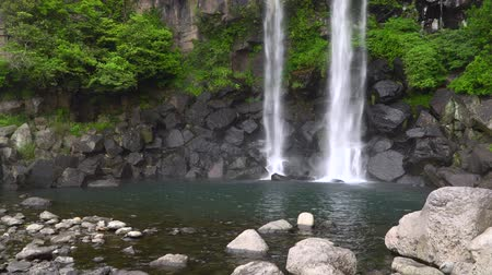 fix : Jeongbang Falls, one of the most famous waterfalls on Jeju Island. The waterfall is 23m high and is an unique waterfall that falls directly into the sea.