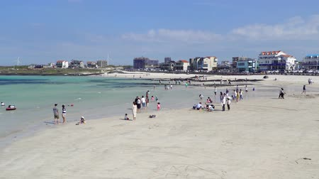 curso : Jeju, Korea - May 22, 2017: Woljeongri beach and Cafe Street. The beach is famous for clean and fine white sand. In recent years, beachfront cafe streets have made the beach more famous.