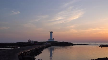 Jeju, Korea - May 25, 2017: Sinchang Windmill Coast is a attraction famous for driving course because of its combination of beautiful natural scenery and wind generator.