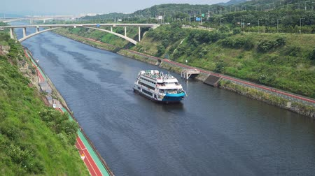 Incheon, Korea - July 31, 2016: Cruise ship on Gyeongin Ara Waterway, which is a canal between Gimpo and Incheon. It was built in 2012 for the purpose of flood control and leisure pursuits.