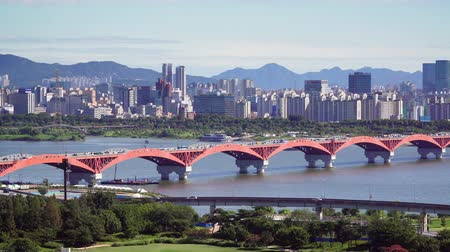 han river : Seoul, Korea - August 26, 2016: Cityscape of Seoul with Seongsan Bridge. Seoul is the capital and largest metropolis of the South Korea. And The bridge is the 12th bridge across the Han River. Stock Footage