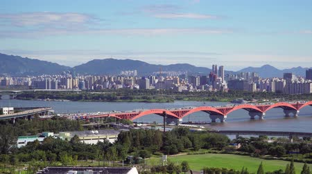 Seoul, Korea - August 26, 2016: Cityscape of Seoul with Han river. Seoul is the capital and largest metropolis of the South Korea. And Han River is the largest river in Korea flowing across Seoul. Stock Footage