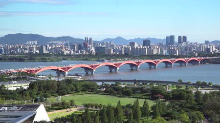 Seoul, Korea - August 26, 2016: Cityscape of Seoul with Seongsan Bridge. Seoul is the capital and largest metropolis of the South Korea. And The bridge is the 12th bridge across the Han River. Stock Footage