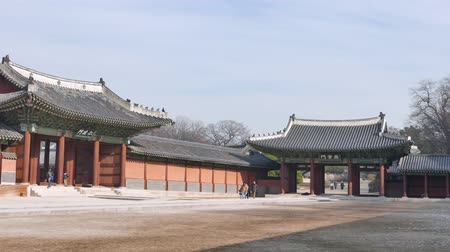династия : Seoul, Korea - December 9, 2015: Injeongmun gate and Sukjangmun gate in Changdeokgung which is a palace built as a secondary palace of the Joseon dynasty in 1405, during King Taejongs reign.