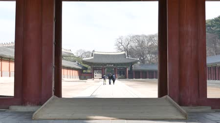 Seoul, Korea - December 9, 2015: Sukjangmun Gate and tourists in Changdeokgung. Changdeokgung is a palace built as a secondary palace of the Joseon dynasty in 1405, during King Taejongs reign.