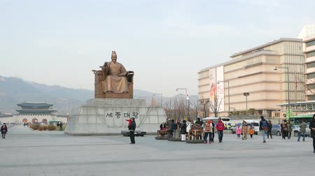 Seoul, Korea - December 9, 2015: King Sejong statue at Gwanghwamun Plaza. The plaza is a public space on Sejongno and it is historical significant as the location of royal administrative buildings. Stock Footage