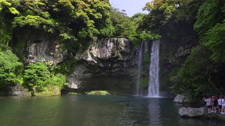 Jeju, Korea - May 25, 2017: Cheonjiyeon waterfalls, one of the most famous waterfalls on Jeju Island. The waterfall is 22m high and the name means sky connected with land.