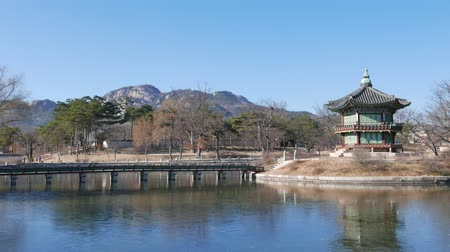 wooden bridge : Seoul, Korea - December 28, 2015: Hyangwonjeong pavilion in Gyeongbokgung. Gyeongbokgung palace was the main palace of the Joseon dynasty.