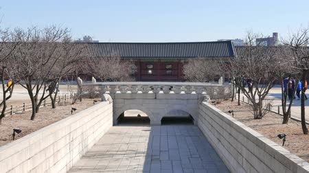 gyeongbokgung : Seoul, Korea - December 28, 2015: Yeongjegyo bridge in Gyeongbokgung. Gyeongbokgung palace was the main palace of the Joseon dynasty, located in northern Seoul. Stock Footage