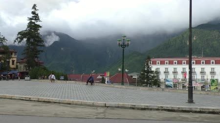north vietnam : Central square of Sapa with traffic and beautiful view of mountains, Vietnam - 09.08.2014