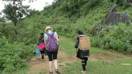north vietnam : Hmong Ethnic women guide a young woman tourist through the forest to village near Sapa, Vietnam