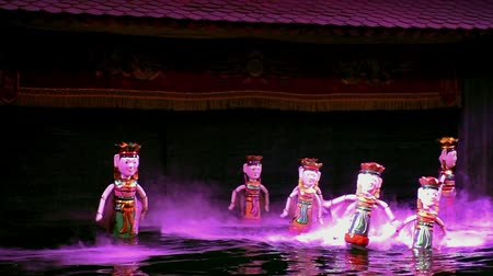 water puppet : VIETNAM, HA NOI, 4 AUGUST 2014 - Dance of Water Puppets in Ha Noi Thang Long Theater in Vietnam Stock Footage