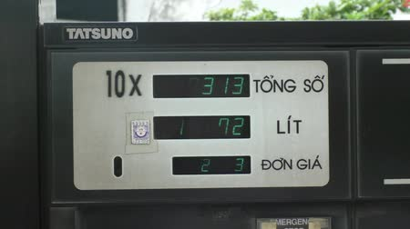 Digital meter of petrol pump counting at the gas station in Vietnam Stock Footage