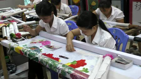 VIETNAM, HA NOI, 14 AUGUST 2014 - Vietnam women embroiderers at the art work on the picture Stock Footage