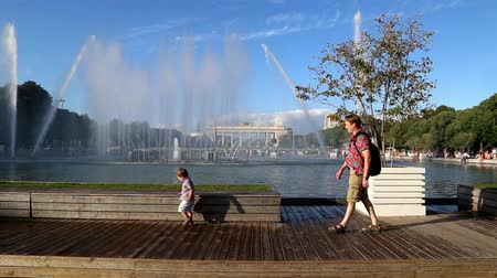 RUSSIA, MOSCOW, PARK KULTURY, 5 AUGUST 2015 - People walk in a city park near the musical fountain in summer