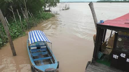 VIETNAM, MEKONG DELTA, 31 JULY 2014 - Traditional vietnamese boats for tourists on Mekong River, Vietnam Stock Footage