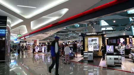 UNITED ARAB EMIRATES, DUBAI, DUBAI INTERNATIONAL AIRPORT, 16 JANUARY 2017 - People walk in a Duty free shop of Dubai International Airport