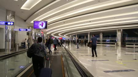 UNITED ARAB EMIRATES, DUBAI INTERNATIONAL AIRPORT, 16 JANUARY 2017 - People walking on a moving pathway - travolator - in the airport. Stock Footage