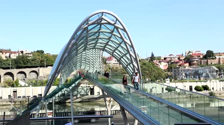 GEORGIA, TBILISI, SEPTEMBER 26, 2016 - Modern glass Bridge of Peace over the river Kura in the old part of Tbilisi, Georgia