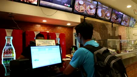 BOLIVIA, SANTA CRUZ DE LA SIERRA, 25 JANUARY 2017 - Man orders lunch in fast food cafe of traditional Bolivian food LA CASA DEL CAMBA in a shopping mall of Santa Cruz, Bolivia Stock Footage