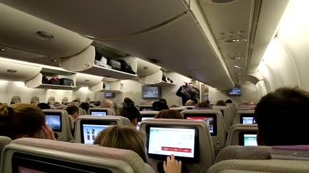 UNITED ARAB EMIRATES, DUBAI, EMIRATES AIRLINES, 16 JANUARY 2017 - Airplane cabin interior with passengers place luggage