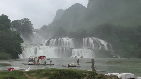 VIETNAM, CAO BANG, 15 AUGUST 2014 - Bamboo Raft with tourists near Ban Gioc or Detian waterfall at the border between Vietnam and China