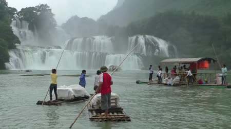 VIETNAM, CAO BANG, 15 AUGUST 2014 - Rafts at the Amazing Ban Gioc or Detian waterfall at the border between Vietnam and China