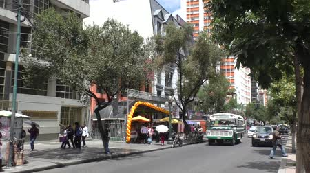 minibus : BOLIVIA, LA PAZ, 13 FEBRUARY 2017 - People and Transport in the Central Prado Street of La Paz, Bolivia Stock Footage