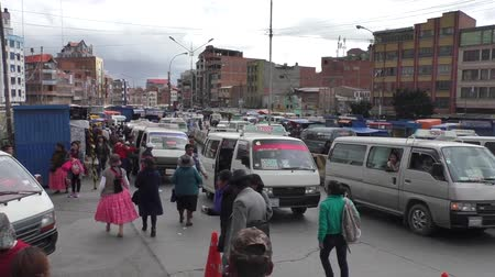 minibus : BOLIVIA, LA PAZ, EL ALTO, 16 FEBRUARY 2017 - Transport traffic jam and crowd of people in a rush hour in El Alto, La Paz, Bolivia, South America