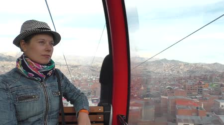 BOLIVIA, LA PAZ, 12 FEBRUARY 2017 - Young woman in La Paz Teleferico Cable car, Bolivia