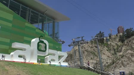 BOLIVIA, LA PAZ, 12 FEBRUARY 2017 - Green line station of La Paz Teleferico Cable car system at 3267 meters above sea level. This is the longest aerial cable car system in the world Stock Footage