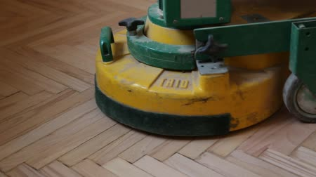 RUSSIA, MOSCOW, 27 APRIL 2015 - Renovation of an old wooden parquet floor with a grinding machine