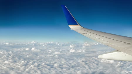 stratosphere : Airplane flying over moving clouds and deep blue sky animation. Stock Footage