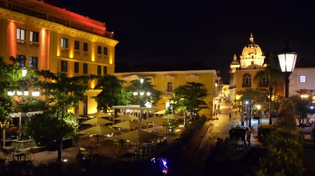 kolombiya : Plaza in the historic center of Cartagena, Colombia as seen at night Stok Video