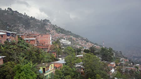 estrutura residencial : Slums of Medellin passing by seen from a cable car
