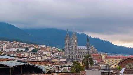 Эквадор : Time lapse video of day becoming night over the basilica in Quito, Ecuador Стоковые видеозаписи