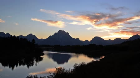 grand tetons : Sunset over the Teton Mountain Range with the Snake River in the foreground
