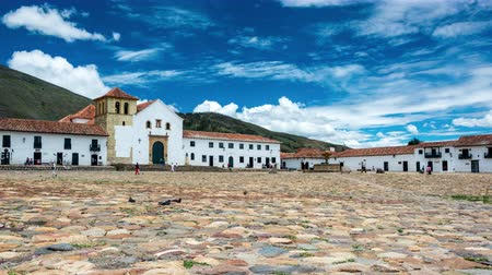 macskaköves : VILLA DE LEYVA, COLOMBIA - APRIL 29: Time lapse video of people passing through the colonial plaza of Villa de Leyva, Colombia on April 29, 2016 with the camera slowly zooming in