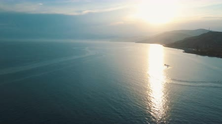 pwc : Scooter driving on Black sea aerial view 4K. Flying high above the sea facing the sun.