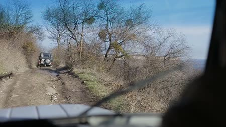 hız göstergesi : Driving off-road car through a forest. Driving old-fashioned off-road automobile. Smooth footage from off road vehicle. Camera follows old-fashioned off-road automobile climbing up a mountain through a forest.