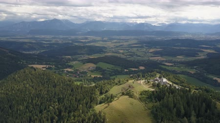 snowcapped : AERIAL view of Magdalensberg, Carinthia, Austria. Mountains as a background Stock Footage