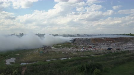 Garbage dump pollutes the environment. Strong wind rises toxic smoke of burning garbage into the air. Dostupné videozáznamy