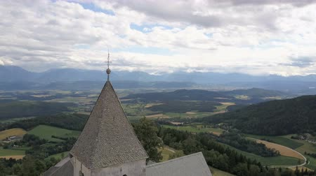 Flight above Ancient church on a mountain. AERIAL view of Magdalensberg, Carinthia, Austria
