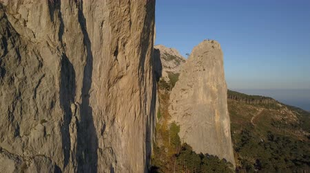 krím : Aerial shot of amazing mountains and rocks in Crimea. Flight close to huge cliff used for rope jumping. Stock mozgókép