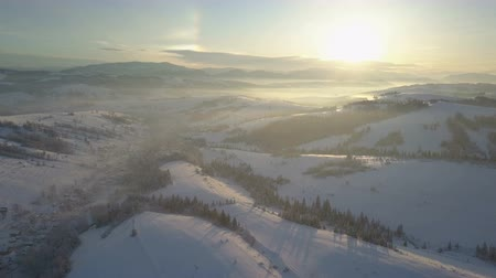 chata : Aerial view of snow-covered mountains. Rural landscape in winter. Flight over a village in Carpathian mountains.