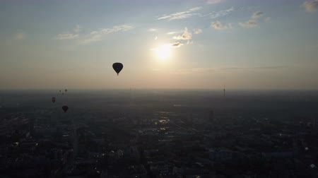 bizakodó : Aerial view of hot air balloons over Vilnius city, Lithuania. Hot air balloons floating over city at dawn. Stock mozgókép