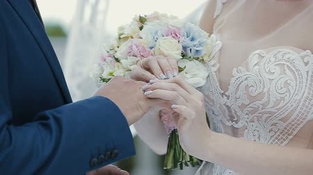 The bride puts the wedding ring on finger of the groom. marriage hands with rings. The bride and groom exchange wedding rings. Dostupné videozáznamy